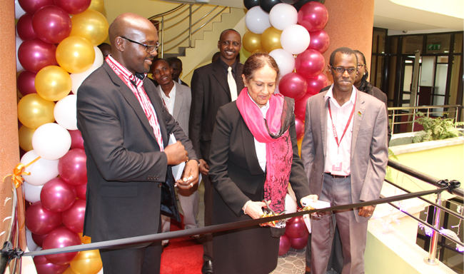 The Hon. Justice Kalpana Rawal, Deputy Chief Justice and Vice President of the Supreme Court (centre), officially opens the new offices of Kenya Law, flanked by Mr. Michael Murungi, CEO (left) and Mr. Long'et Terer, Deputy CEO (right)
