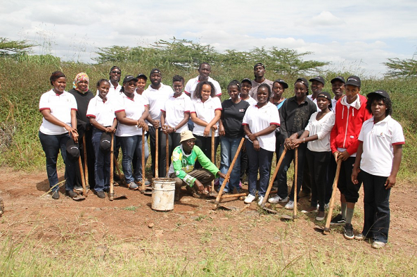 Part of the Kenya Law staff and the Greenline forester Mr. Simon Waithaka pose for a photo after planting 250 trees at the Nairobi National Park.