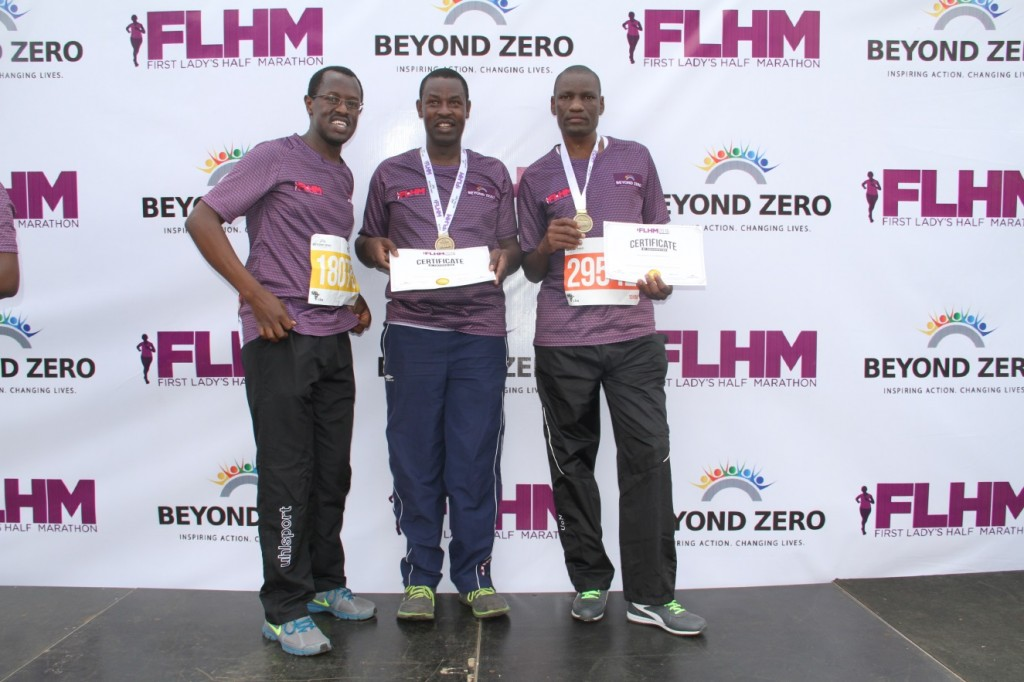 Kenya Law CEO, Mr. Long'et Terer (left) joins Kenya Law employees, James Onguso (Middle) and Fredrick Abea (Right), for a picture after completing the First Lady's Half Marathon at the Nyayo Stadium on March 6, 2016.
