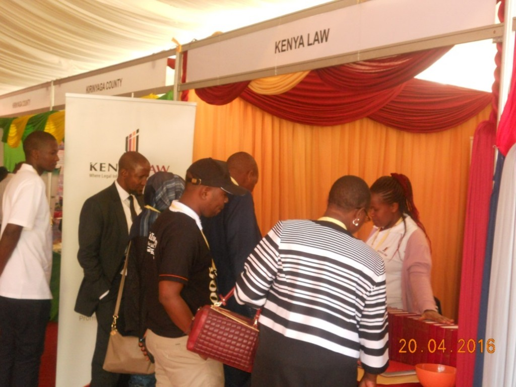 Ms. Carolyne Wairimu(right) engages delegates at the Kenya Law stand during the 3rd Annual Devolution conference on held at the Meru National Polytechnic on 20th April 2016.
