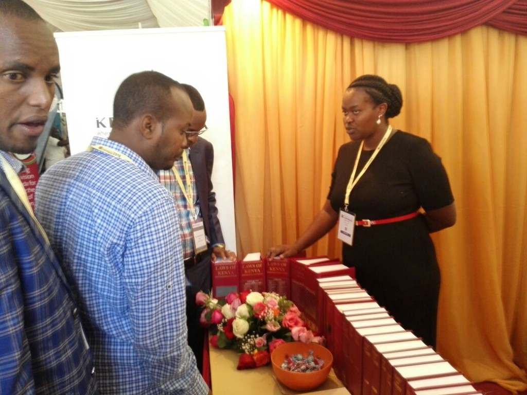 Ms. Wambui Kamau, Team leader at Kenya Law(right) speaks to delegates at the Kenya Law stand during the 3rd Annual Devolution conference on held at the Meru National Polytechnic on 20th April 2016.
