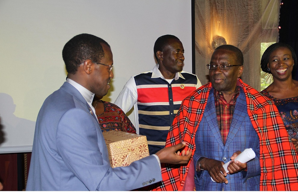 Kenya Law CEO/Editor Mr. Long'et Terer presents a gift to the former Chief Justice Dr. Willy Mutunga during the 6th Kenya Law Annual Staff Conference on 26th August 2016