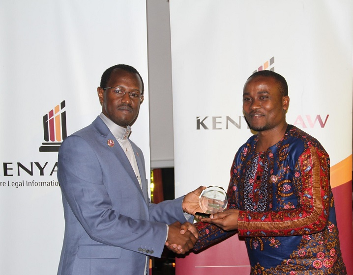 Kenya Law CEO/Editor Mr. Long'et Terer presents the 2016 -Team player of the Year, SMCC department to Mr. Joseph Asige. Joseph  was also the 2nd runners up; employee of the year category.