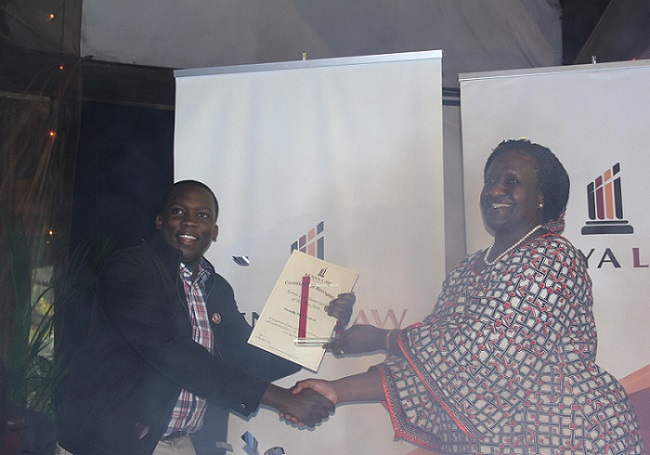 Kenya Law I.C.T Team Leader Mr. Martin Andago receives the Team Leader of the Year -2016 award from Ms. Christine Agimba