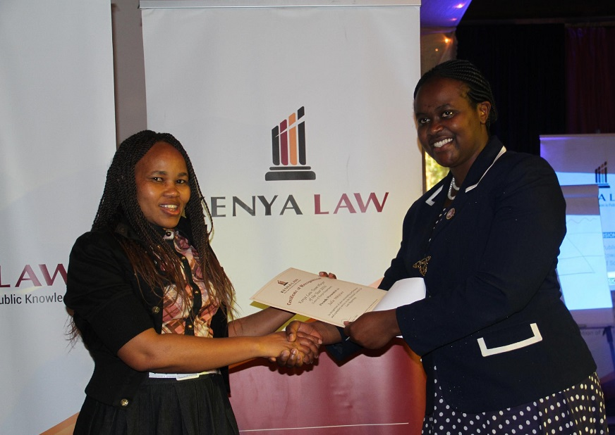 Ms Julie Mbijiwe of the Laws of Kenya(LOK) department receives an award for the 2016 Kenya Law innovator of the year from the LOK team leader Mrs. Wambui Kamau.