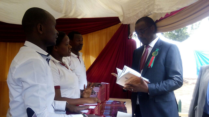 Nairobi County Governor Dr. Evans Kidero takes a glimpse of cases compiled in the Supreme Court case digests volume 1