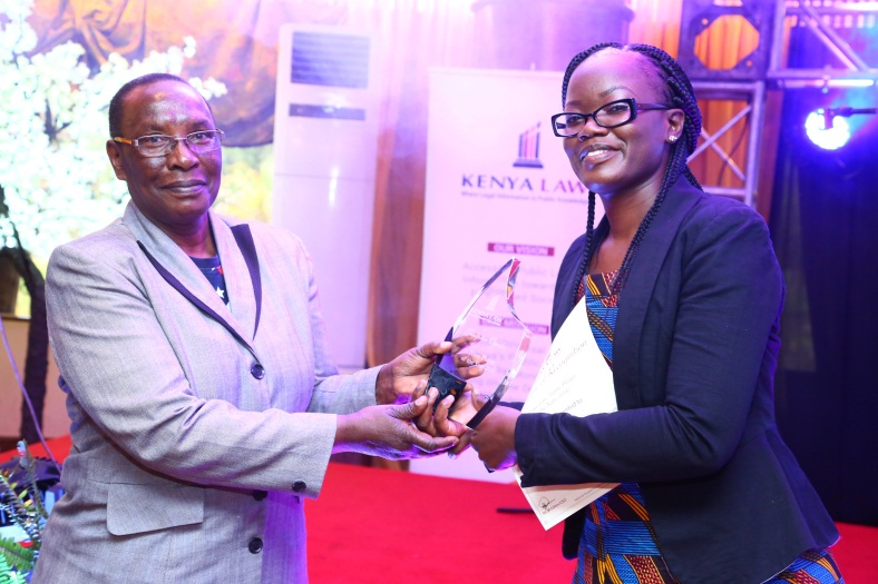 Outgoing Council member for Law Reporting Hon. Lady Justice Roselyne. Nambuye(left ) presents  the overall  team player  award to Ms.  Jennifer Ogada of Law Reporting department