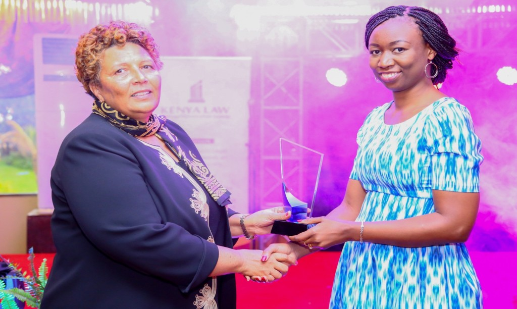 Hon. Lady Justice Fatuma  Sichale(left) presents the Team Leader of the Year Award to Ms. Linda Awuor of the Reasearch and Development Department.