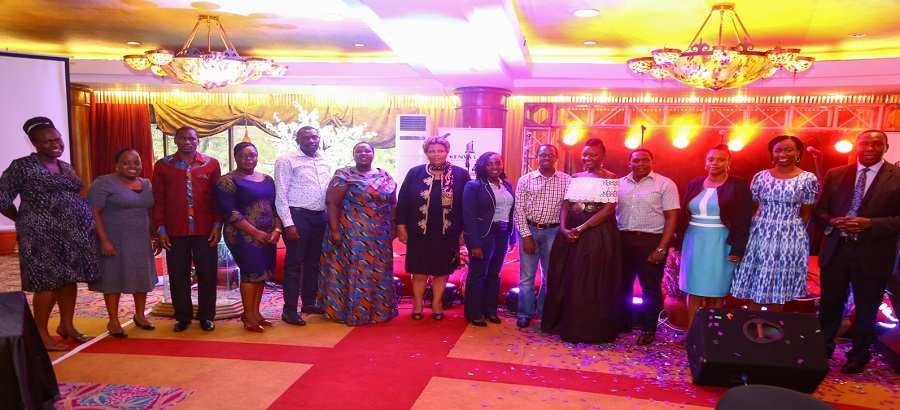 The Chief guest Hon. Lady Justice Fatuma  Sichale(7th left) and Kenya Law CEO Mr. Longet Terer(6th right) pose for a picture with members of the council for Law Reporting  and Kenya Law managers during the 7th Annual Staff Conference.