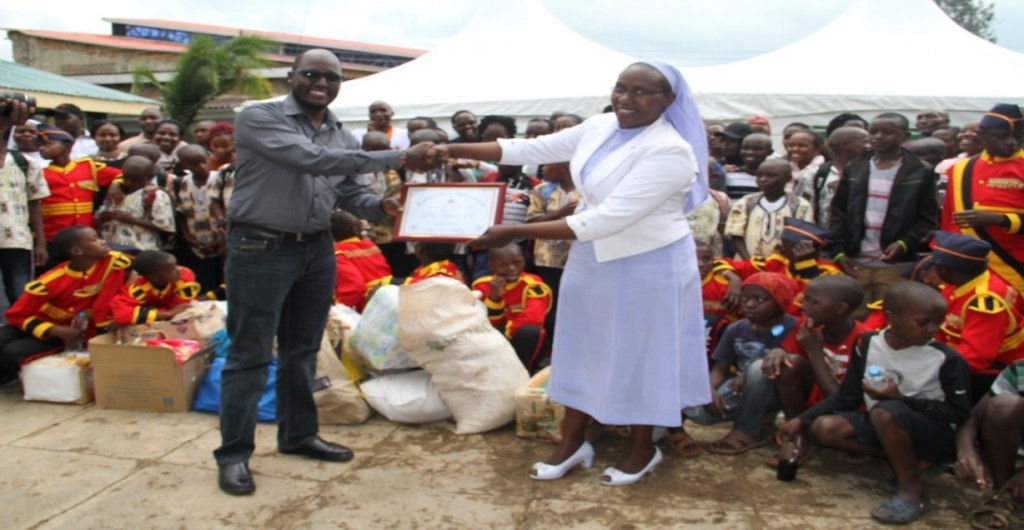 Nelson Tunoi, Chairman Kenya Law Welfare association receives a certificate of appreciation from the Director Kwetu Home of Peace Sr.  Carol. Kenya Law welfare association visited the children's home in Madaraka on Friday the 20th of April 2018 and donated food stuff, stationery, books, school bags, shoes, socks and other.