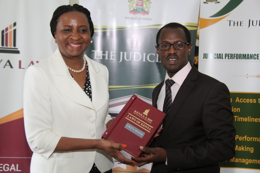 Kenya Law CEO Mr. Long'et Terer presents the new Grey Book to the Chief Registrar of the Judiciary Hon. Ann Amadi during a hand over event at the Supreme Court Building, Nairobi, on 7th September 2018. Kenya Law published the books with the support of the Judiciary Performance Programme (JPIP)