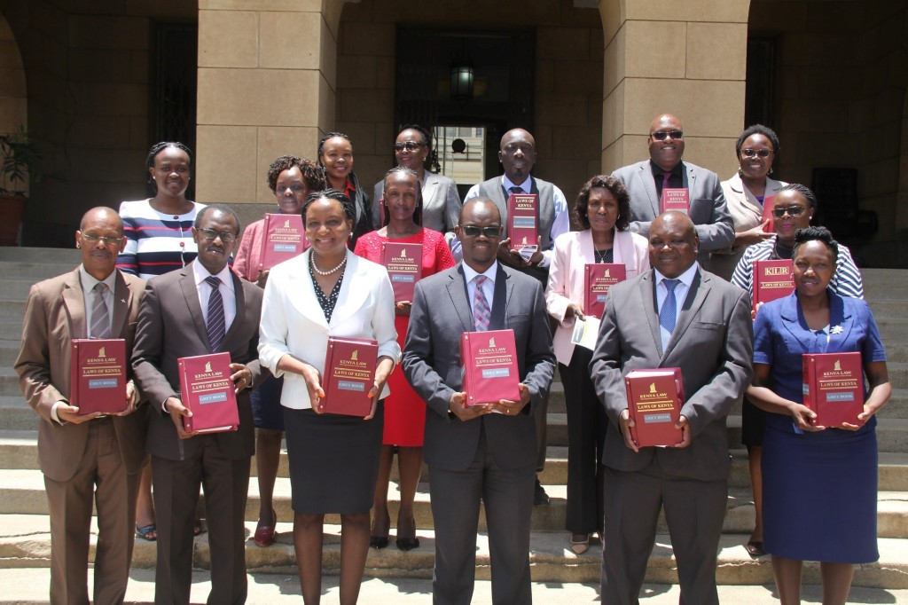 Kenya Law CEO Mr. Long'et Terer (second left) and the Chief Registrar of the Judiciary Hon. Ann Amadi ( third left) join various  court  registrars as they show off  their new 2017 Grey books  during the grey book hand over  event at the Supreme Court Building,  Nairobi, on 7th September 2018. Kenya Law published the books with the support of the Judiciary Performance Programme (JPIP)