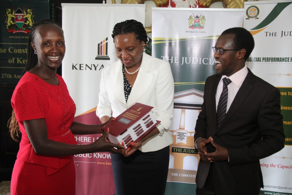 Chief Registrar of the Judiciary Hon. Ann Amadi (Center) hands over the 2017 Grey Book to the Registrar of the Supreme Court during a Grey Book hand- over event at the Supreme Court Building Nairobi, on 7th September 2018. Kenya Law published the books with the support of the Judiciary Performance Programme (JPIP)
