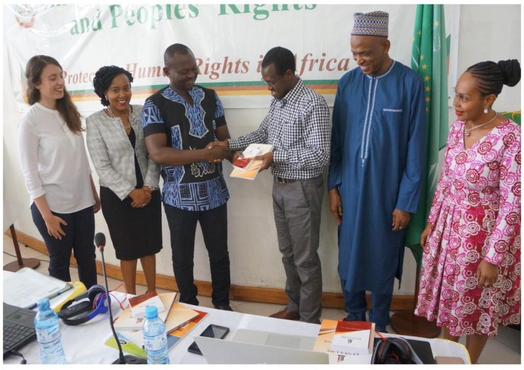 Mr. Long'et Terer CEO/Editor- Kenya Law hands over books to Dr. R. Eno, Registrar of African Court (3rd left) in Arusha.