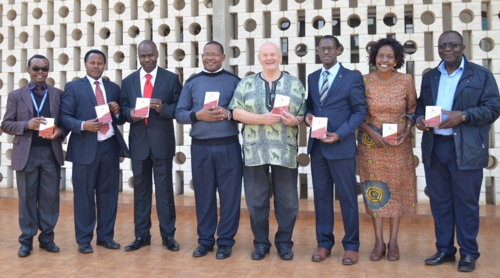 Kenya Law CEO Mr. Long'et Terer (third right) and the Principal Tangaza University College Br. Tom Kearney C.F.C ( fourth right) join various University administrators  as they display Copies of the Constitution donated to Tangaza University College, Nairobi, on October 30, 2018.