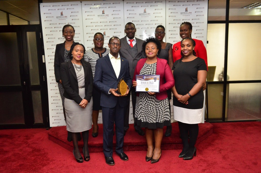 Kenya Law CEO Mr. Long'et Terer (Second left)and Deputy CEO Ms. Janet Munywoki  are joined by Kenya Law Management team  for a picture after winning the Best Public Sector Legal Department 2019' Award at the Nairobi Legal Awards on 30th June 2019.